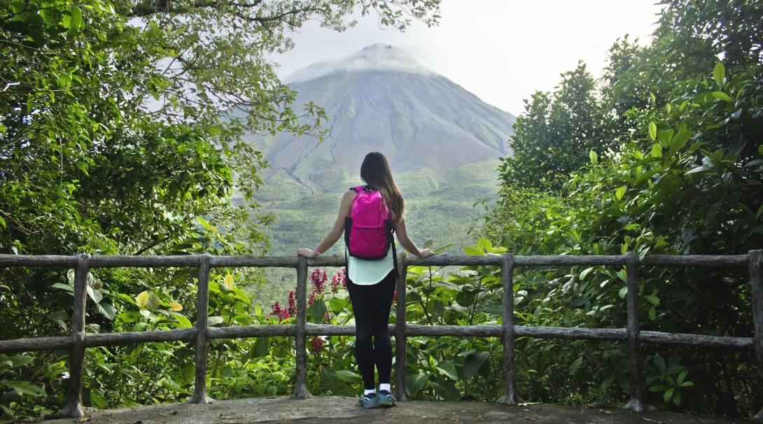 Traveller climbs to Arenal Volcano in Costa Rica during her trip abroad.